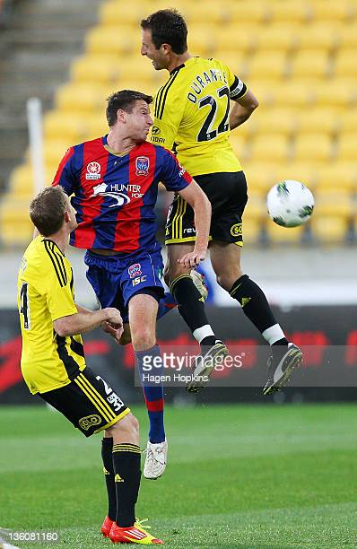 Andrew Durante of the Phoenix challenges for a header with Michael Bridges of the Jets during the round 12 ALeague match between Wellington Phoenix...