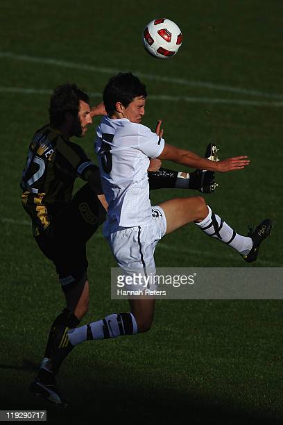 Andrew Durante of the Phoenix competes with Sean Lovmore of the Junior All Whites during the preseason friendly match between the Wellington Phoenix...