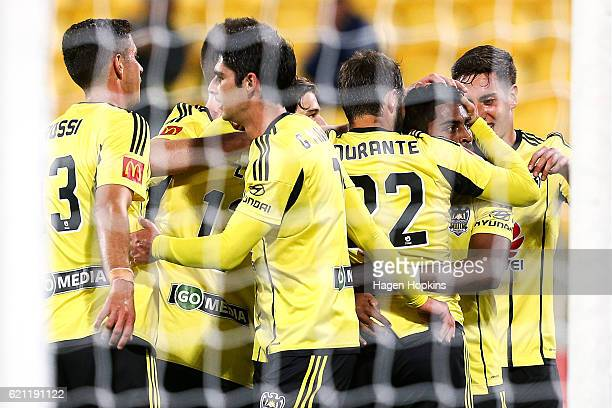 Andrew Durante of the Phoenix congratulates teammate Roy Krishna on his second goal during the round five ALeague match between the Wellington...