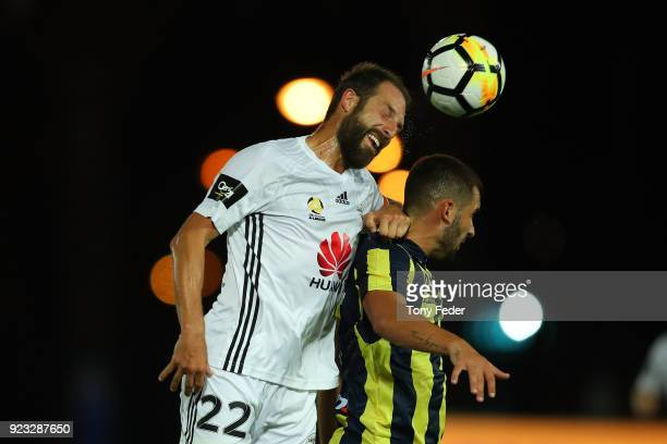 Andrew Durante of the Phoenix contests a header with Petros Skapetis during the round 21 ALeague match between the Central Coast Mariners and the...