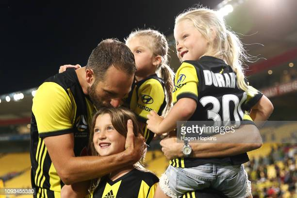 Andrew Durante of the Phoenix greets his three daughters Adalyn Milana and Evita during the round 13 ALeague match between the Wellington Phoenix and...
