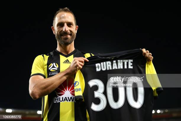 Andrew Durante of the Phoenix holds a commemorative jersey to mark his 300th game during the round 13 ALeague match between the Wellington Phoenix...