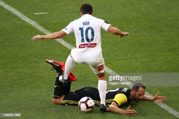 Andrew Durante of the Phoenix loses his footing in the tackle of Tommy Oar of the Mariners during the round 13 ALeague match between the Wellington...