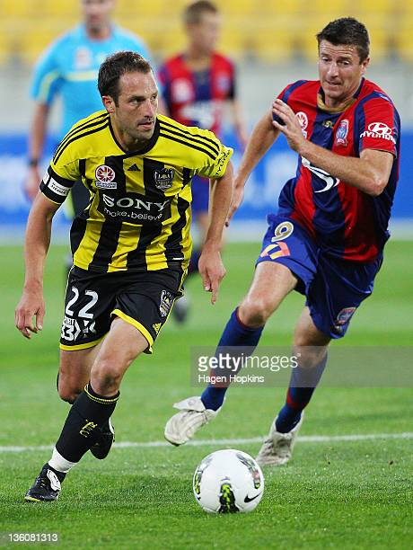 Andrew Durante of the Phoenix runs the ball under pressure from Michael Bridges of the Jets during the round 12 ALeague match between Wellington...