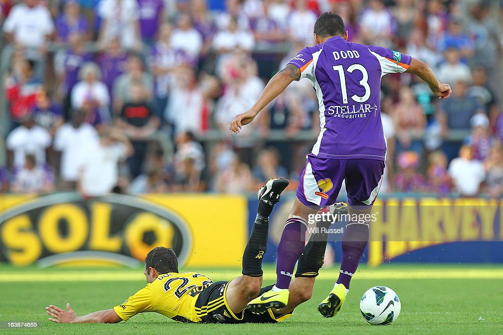 Andrew Durante of the Wellington Phoenix trips whilst tackled by Travis Dodd of the Glory during the round 25 A-League match between the Perth Glory and the Wellington Phoenix at nib Stadium on March 17, 2013 in Perth, Australia.