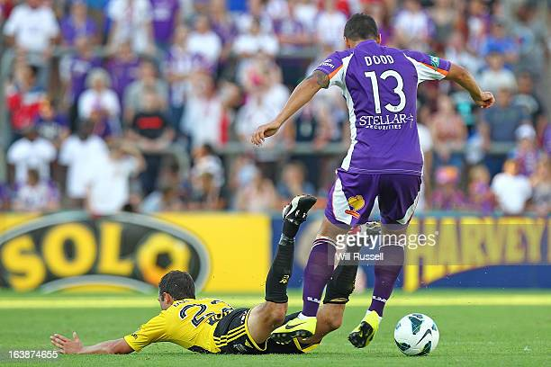 Andrew Durante of the Wellington Phoenix trips whilst tackled by Travis Dodd of the Glory during the round 25 ALeague match between the Perth Glory...