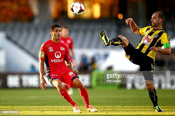 Andrew Durante of Wellington and Marcelo Carrusca of Adeliade contest the ball during the round 17 ALeague match between Wellington Phoenix and...