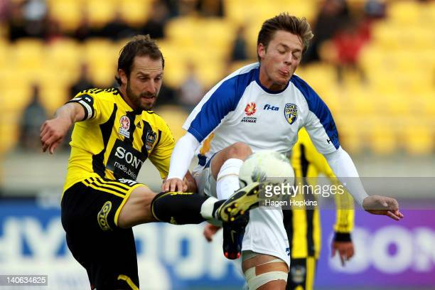 Andrew Durante of Wellington competes for the ball with Chris Harold of Gold Coast during the round 22 ALeague match between Wellington Phoenix and...