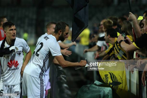 Andrew Durante of Wellington Phoenix celebrates with fans during the round 21 ALeague match between the Central Coast Mariners and the Wellington...