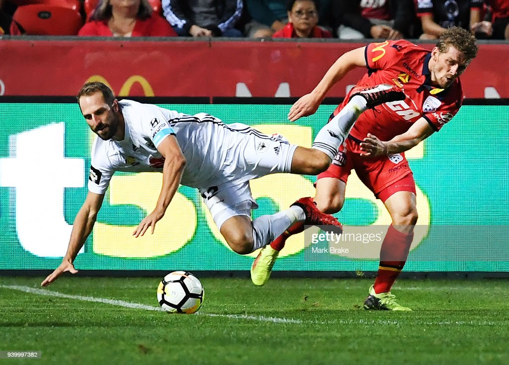 Andrew Durante of Wellington Phoenix is fouled by Johan Absalonsen of Adelaide United during the round 25 A-League match between Adelaide United and the Wellington Phoenix at Coopers Stadium on March 30, 2018 in Adelaide, Australia.