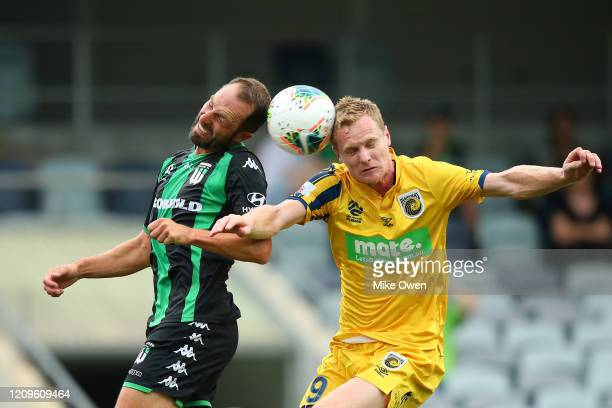 Andrew Durante of Western United and Matt Simon of the Mariners head the ball during the round 21 A-League match between Western United and the...