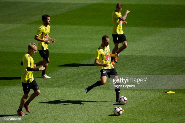 Andrew Durante passes while Mitch Nichols Tom Doyle and Armado Sosa Pena look on during a Wellington Phoenix training session at Westpac Stadium on...