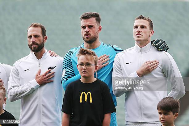 Andrew Durante Stefan Marinovic and Chris Wood of New Zealand sing the national anthem prior to the 2018 FIFA World Cup Qualifier match between the...