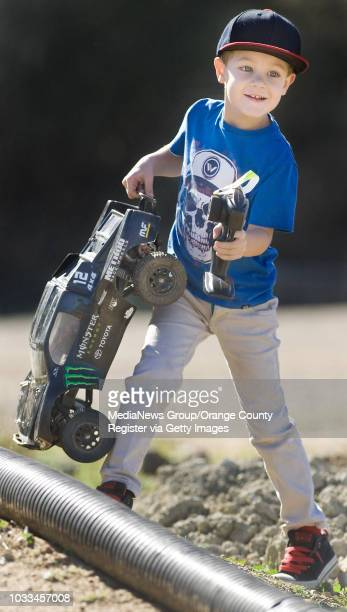 Andrew Durkee of Huntington Beach gets ready to take his remotecontrol car for a spin on a track designed for kids and beginners at Irvine Lake...
