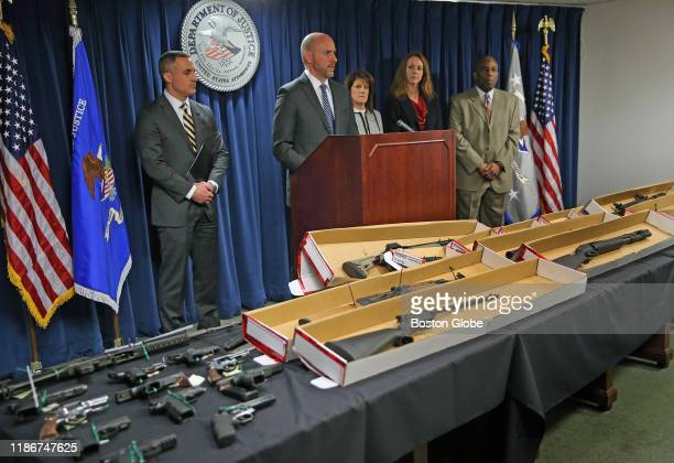 Andrew E. Lelling, United States Attorney for the District of Massachusetts, speaks at the podium during a press conference at the John Joseph...