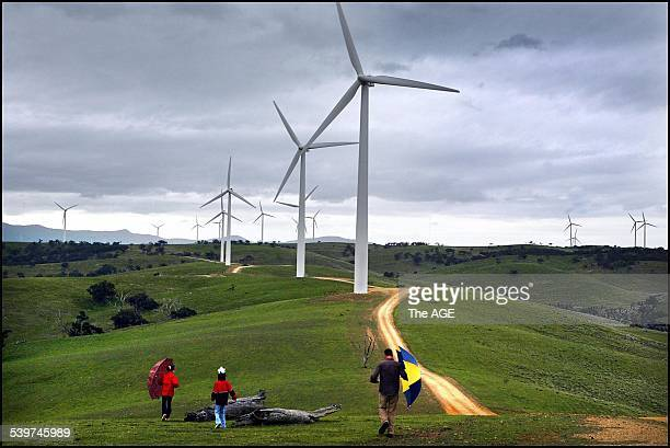 Andrew Eastick and his daughters Georgie, 12 and Zoe, 10 at the wind farm near Ararat. Andrew believes wind farms in the region could benefit his...