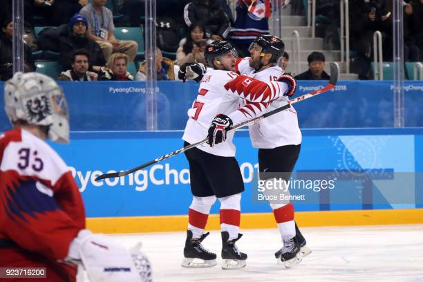 Andrew Ebbett of Canada celebrates scoring in the third period with Brandon Kozun against Pavel Francouz of the Czech Republic during the Men's...