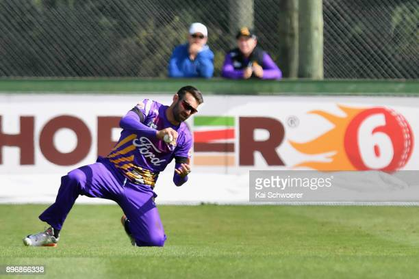 Andrew Ellis of Canterbury takes a catch to dismiss Tom Bruce of the Central Stags during the Super Smash match between the Canterbury Kings and the...