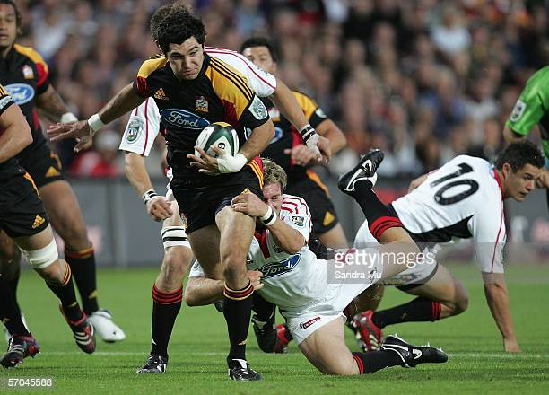 Andrew Ellis of the Crusaders makes a tackle on Stephen Donald of the Chiefs during the round five Super 14 game between the Crusaders and Chiefs at...