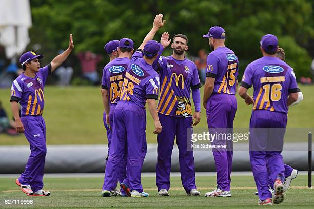 Andrew Ellis of the Kings is congratulated by team mates after dismissing Chris Green of the Thunder during the T20 practice match between Canterbury...