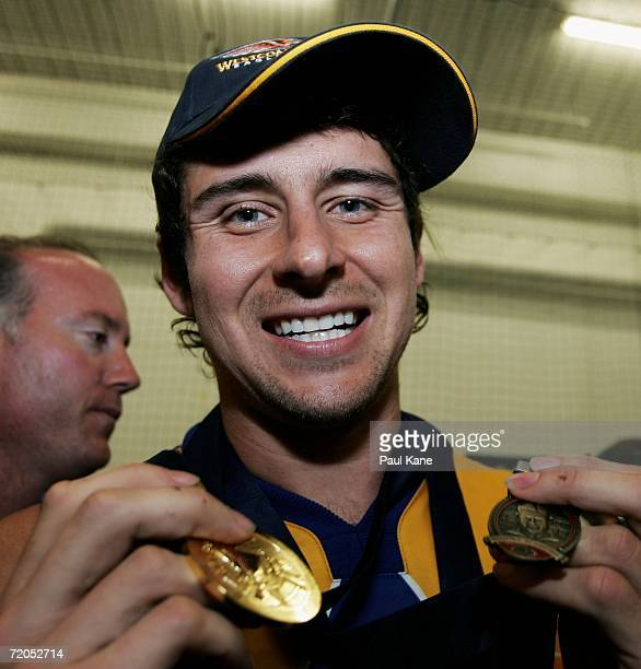 Andrew Embley of the Eagles poses with his Premiership medal and his Norm Smith medal in the rooms after the AFL Grand Final match between the Sydney...