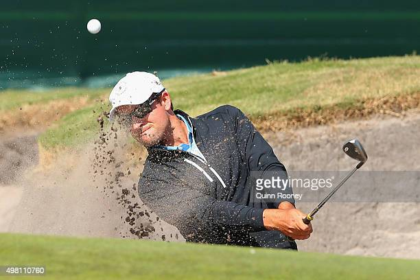 Andrew Evans of Australia plays out of the bunker during day three of the 2015 Australian Masters at Huntingdale Golf Club on November 21, 2015 in...