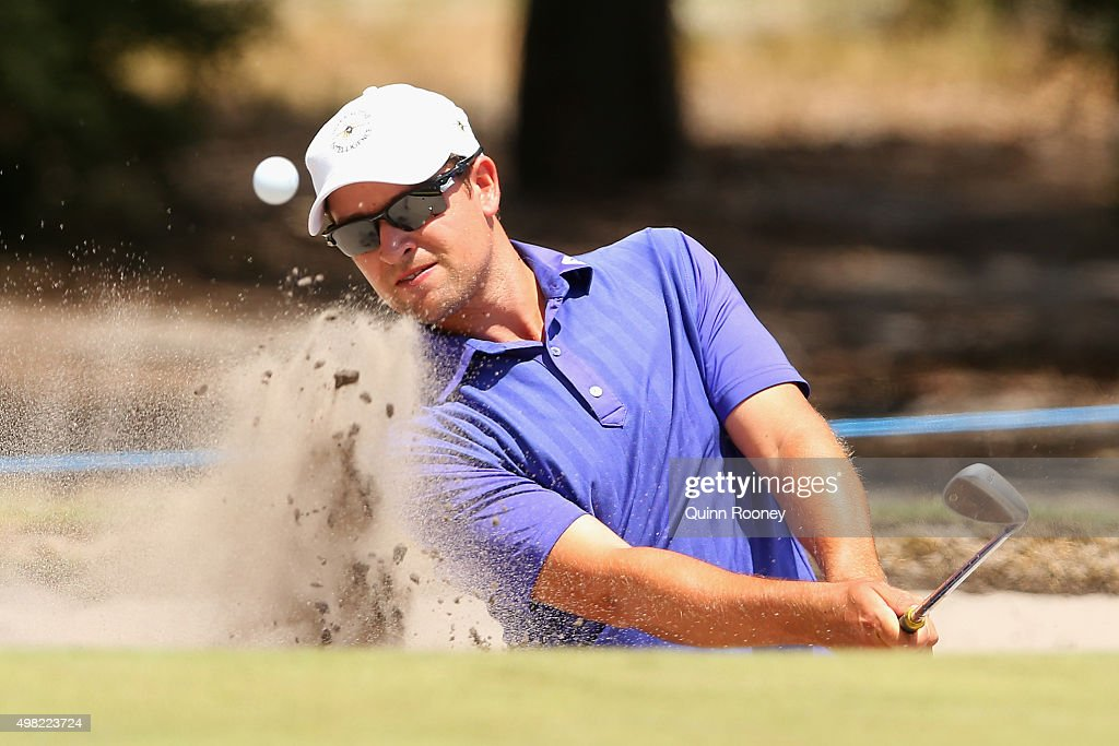 Andrew Evans of Australia plays out of the bunker during the final round of the 2015 Australian Masters at Huntingdale Golf Club on November 22, 2015 in Melbourne, Australia.