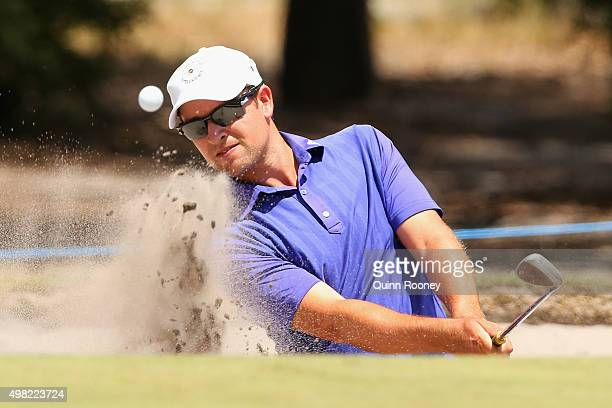 Andrew Evans of Australia plays out of the bunker during the final round of the 2015 Australian Masters at Huntingdale Golf Club on November 22, 2015...