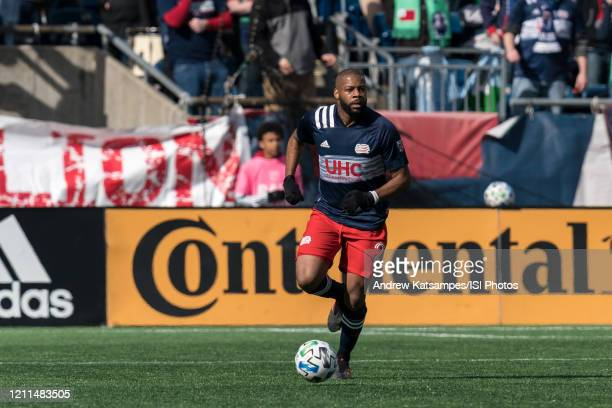 Andrew Farrell of New England Revolution brings the ball forward during a game between Chicago Fire and New England Revolution at Gillette Stadium on...