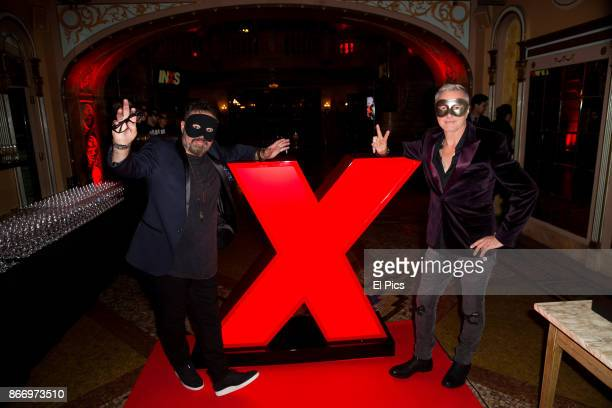 Andrew Farriss and Garry Gary Beers arrive ahead of the INXS Masquerade Party at State Theatre on October 26 2017 in Sydney Australia