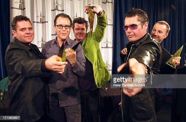 Andrew Farriss Kirk Pengilly Tim Farriss Jon Farriss and Garry Gary Beers of the rock band INXS in the awards room backstage at the 15th Annual ARIA...
