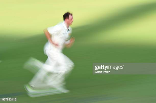 Andrew Fekete of Queensland bowls during day three of the Sheffield Shield Final match between Queensland and Tasmania at Allan Border Field on March...