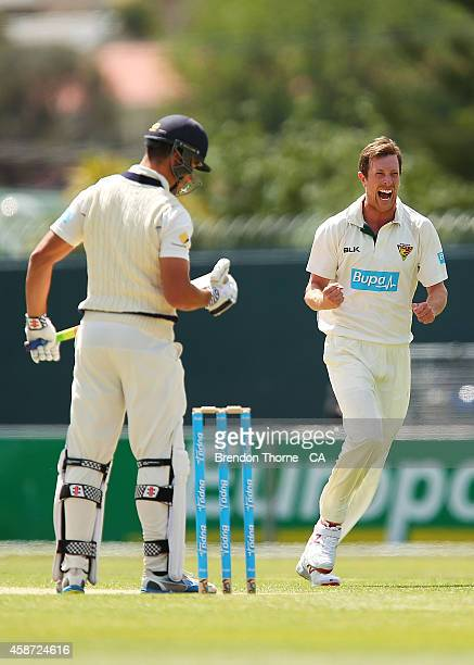 Andrew Fekete of Tasmania celebrates after claiming the wicket of Marcus Stoinis of Victoria during day three of the Sheffield Shield match between...