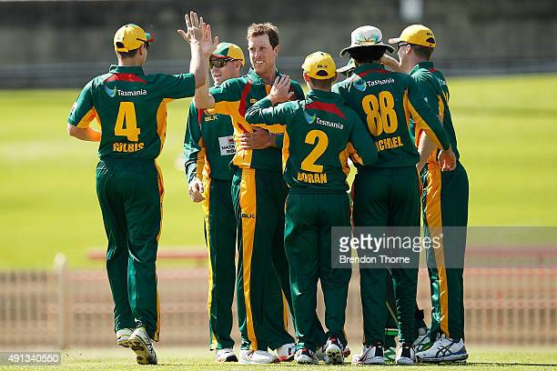Andrew Fekete of Tasmania celebrates with team mates after claiming the wicket of Chris Hartley of Qld during the Matador BBQs One Day Cup match...