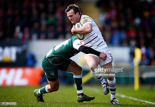 Andrew Fenby of London Irish is tackled by Mathew Tait of Leicester during the Aviva Premiership match between Leicester Tigers and London Irish at...