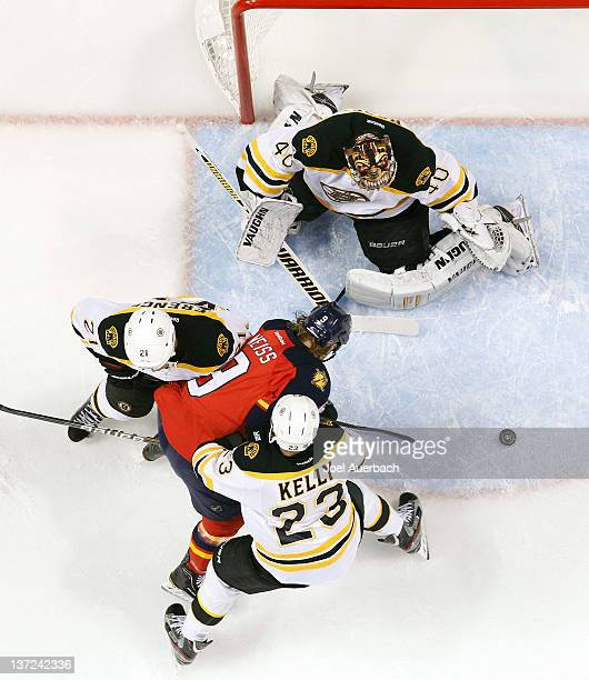 Andrew Ference and Chris Kelly of the Boston Bruins tie up Stephen Weiss of the Florida Panthers as goaltender Tuukka Rask defends the net on January...