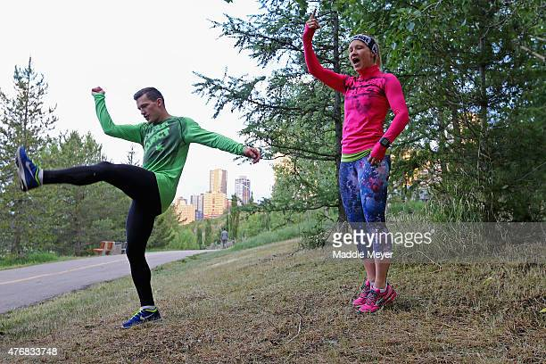 Andrew Ference and his sister Jen direct participants during a November Project workout at Louise McKinney Riverfront Park on June 12 2015 in...