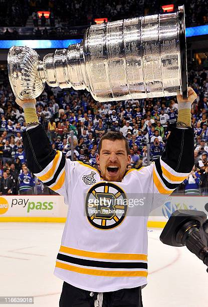 Andrew Ference of the Boston Bruins celebrates winning the Stanley Cup after defeating the Vancouver Canucks 40 in Game Seven of the 2011 NHL Stanley...