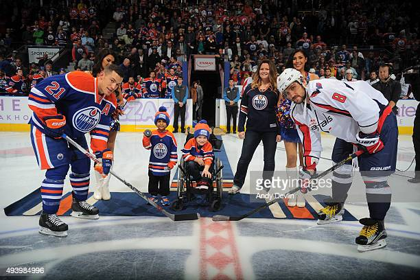 Andrew Ference of the Edmonton Oilers and Alex Ovechkin of Washington Capitals pose for the ceremonial puck drop on October 23 2015 at Rexall Place...