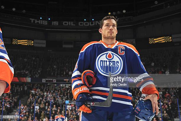Andrew Ference of the Edmonton Oilers stands for the singing of the national anthem prior to the game against the New Jersey Devils on November 21...