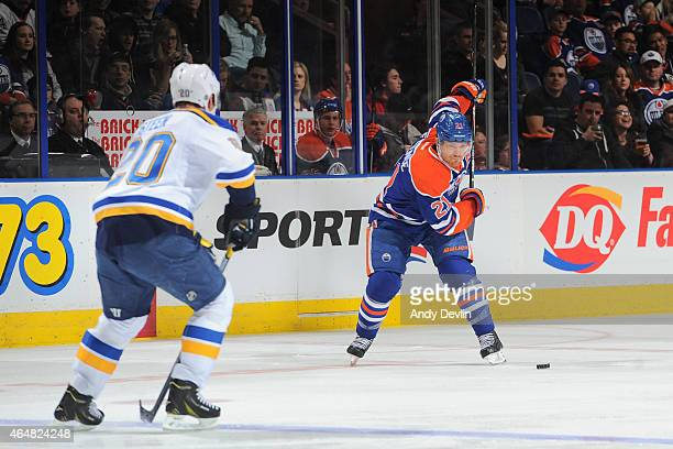 Andrew Ference of the Edmonton Oilers takes a slap shot as Alexander Steen attempts to block the shot on February 28 2015 at Rexall Place in Edmonton...