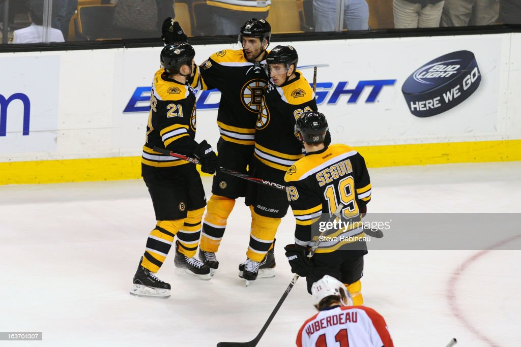 Andrew Ference #21, Patrice Bergeron #37, Brad Marchand #63 and Tyler Seguin #19 of the Boston Bruins celebrate a empty net goal against the Florida Panthers at the TD Garden on March 14, 2013 in Boston, Massachusetts.