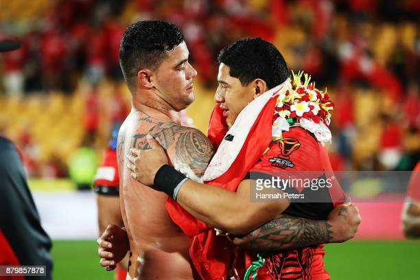 Andrew Fifita and Jason Taumalolo of Tonga embrace after losing the 2017 Rugby League World Cup Semi Final match between Tonga and England at Mt...