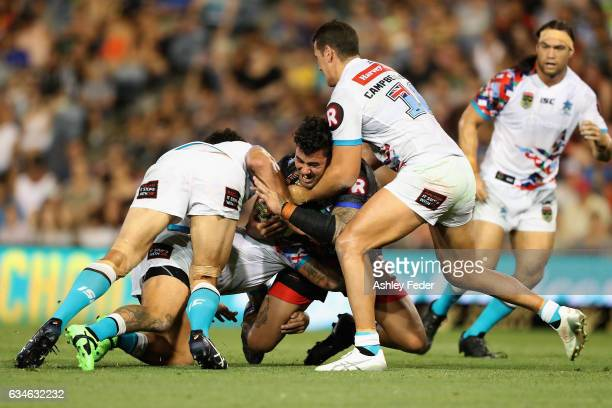 Andrew Fifita of Indigenous All Stars is tackled by the World All Stars defence during the NRL All Stars match between the 2017 Harvey Norman All...