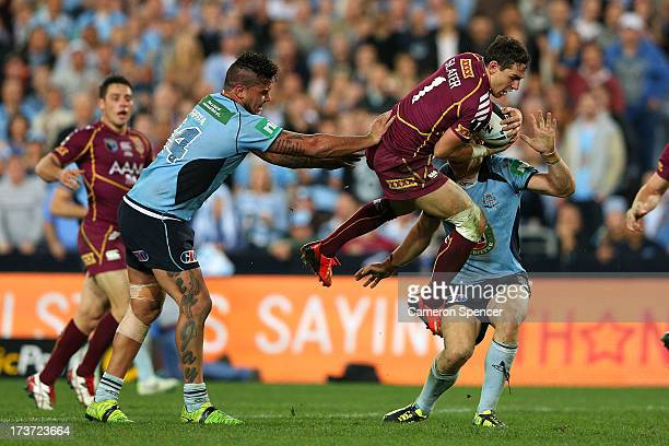 Andrew Fifita of the Blues pushes Billy Slater of the Maroons during game three of the ARL State of Origin series between the New South Wales Blues...