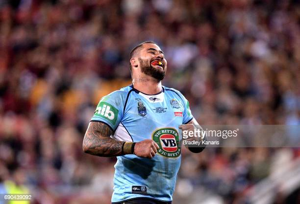 Andrew Fifita of the Blues smiles at the crowd after scoring a try during game one of the State Of Origin series between the Queensland Maroons and...