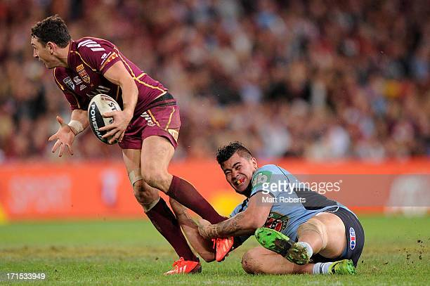 Andrew Fifita of the Blues tackles Billy Slater of the Maroons during game two of the ARL State of Origin series between the Queensland Maroons and...