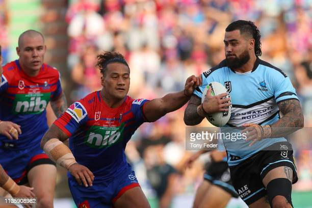 Andrew Fifita of the Cronulla Sharks is tackled during round one NRL match between the Newcastle Knights and the CronullaSutherland Sharks at...