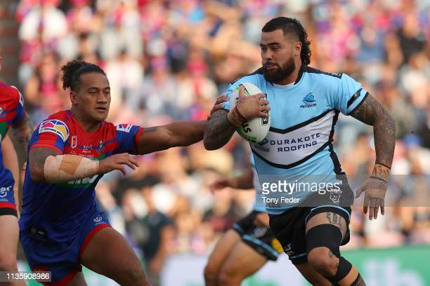 Andrew Fifita of the Cronulla Sharks is tackled during round one NRL match between the Newcastle Knights and the Cronulla-Sutherland Sharks at...