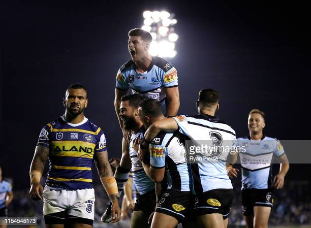 Andrew Fifita of the Sharks celebrates with Chad Townsend of the Sharks after scoring a try during the round 13 NRL match between the Cronulla Sharks...